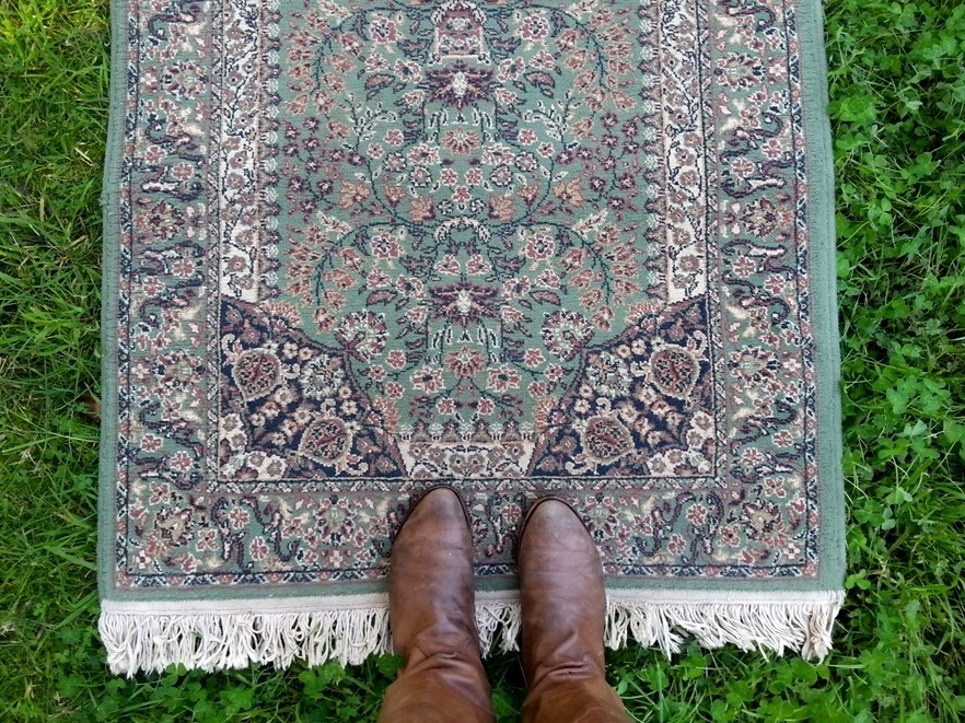 Green vintage persian rug available to hire