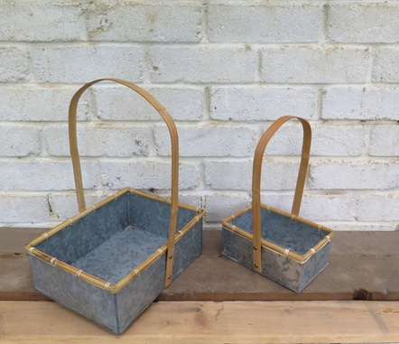 Pair of tin baskets available to hire