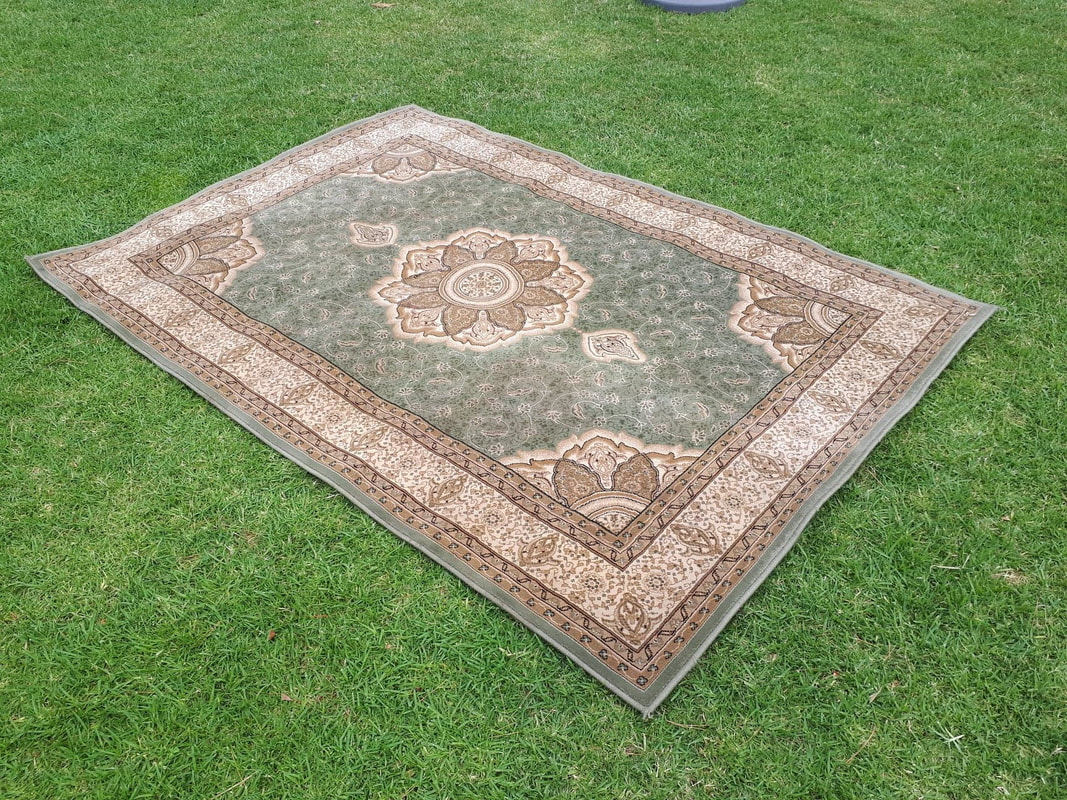 Coral vintage persian rug available to hire